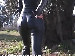 Cute brunette posing in leather pants and leather jacket