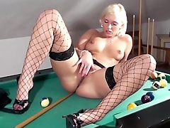 Blonde masturbates in fishnet stockings with an increment of heels