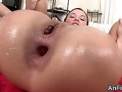 Flirty lesbian babes are stretching with the addition of fisting anals