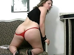 Chubby Tgirl in red cords exposes big boobs and tranny cock